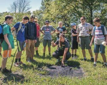 Leave No Trace trainer providing field lesson to onlooking students