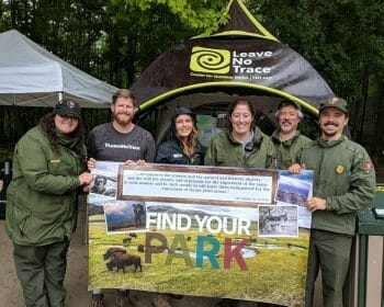 Group of national park rangers posing with a LNT traveling trainer