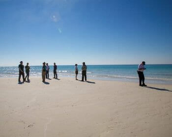 Group of volunteers gathered on a beach