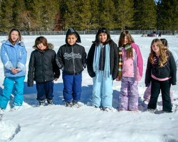 Group of children standing in a snowy field