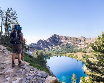 Hiker staring over blue lake