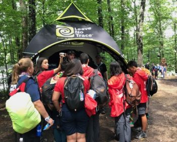Group of children surrounding Leave No Trace pop-up tent